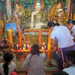 Cambodia volunteer lighting candles in temple
