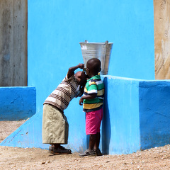 Ghana children by wall