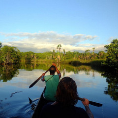 Madagascar canoeing on river