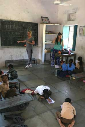 Volunteers teaching in a community school in Udaipur