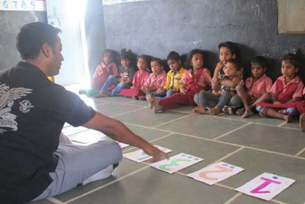 Ravi leading an activity session at a day care centre