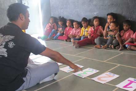 Ravi leading an educational activity at the day care centre