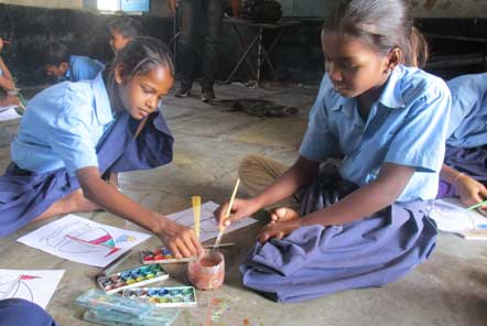 Children at the school learning how to use water colour paints