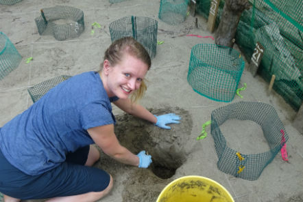 Lucy from the Pod Volunteer team doing excavation duty