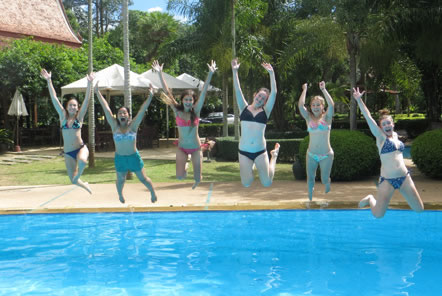Volunteers jumping in the pool in Thailand