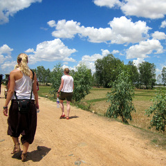 Cambodia volunteers walking on dirt road