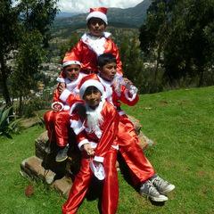 Christmas volunteering children in santa outfits