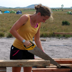 Community volunteering volunteer sawing