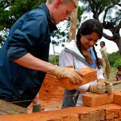 Community volunteering brick laying