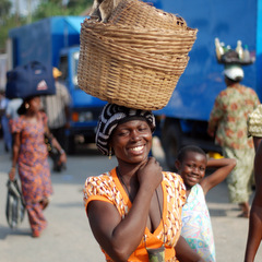 Ghana local woman carrying basket