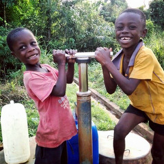Ghana children with water pump